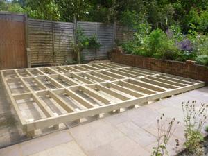 Timber subframe base on sloping ground